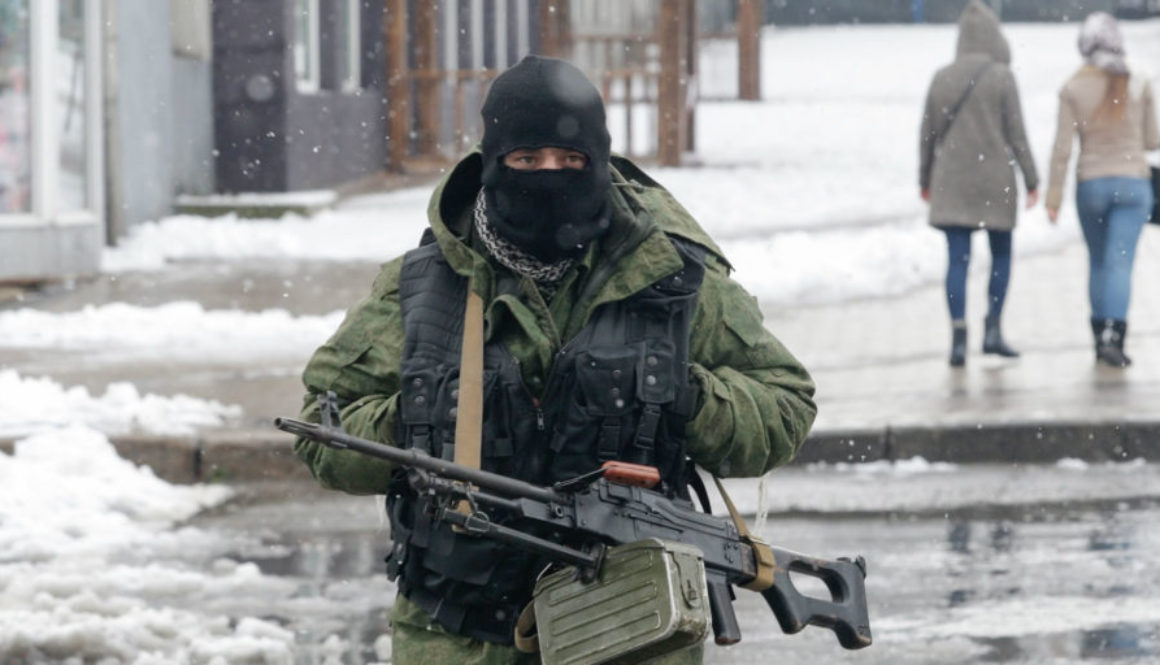 An armed man stands guard in a downtown of pro-Russian rebels controlled Luhansk city, Ukraine, 22 November 2017