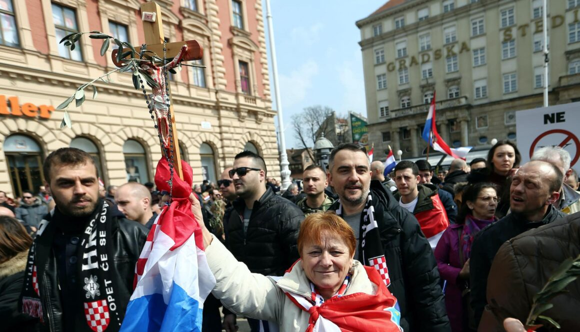 A woman holds a cross during the protest against the ratification of the Istanbul Convention in Zagreb