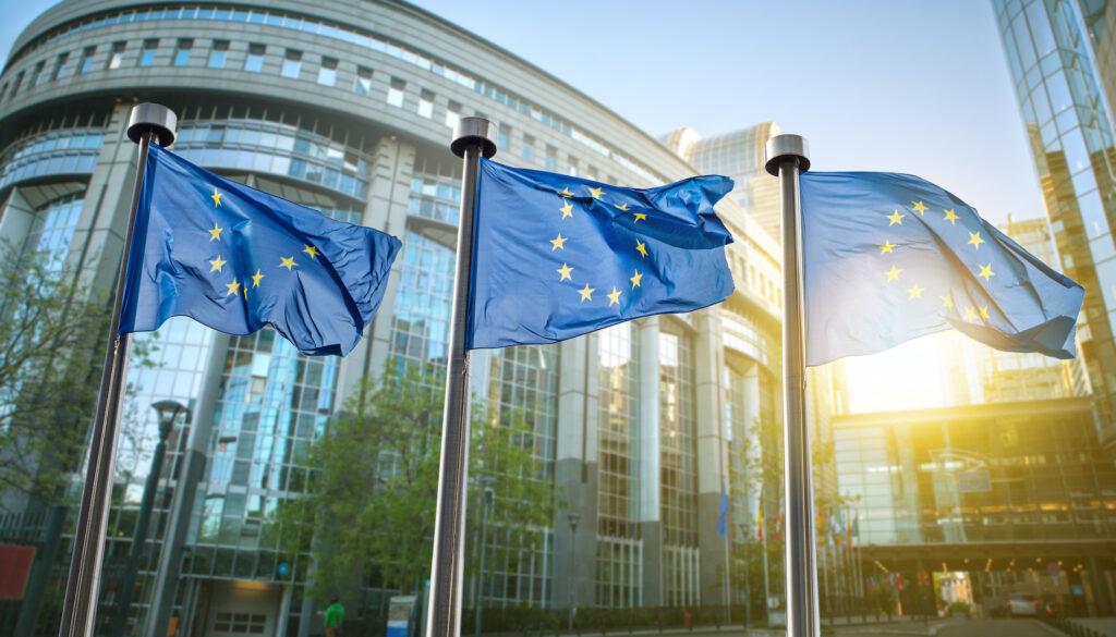 European,Union,Flag,Against,Parliament,In,Brussels,,Belgium